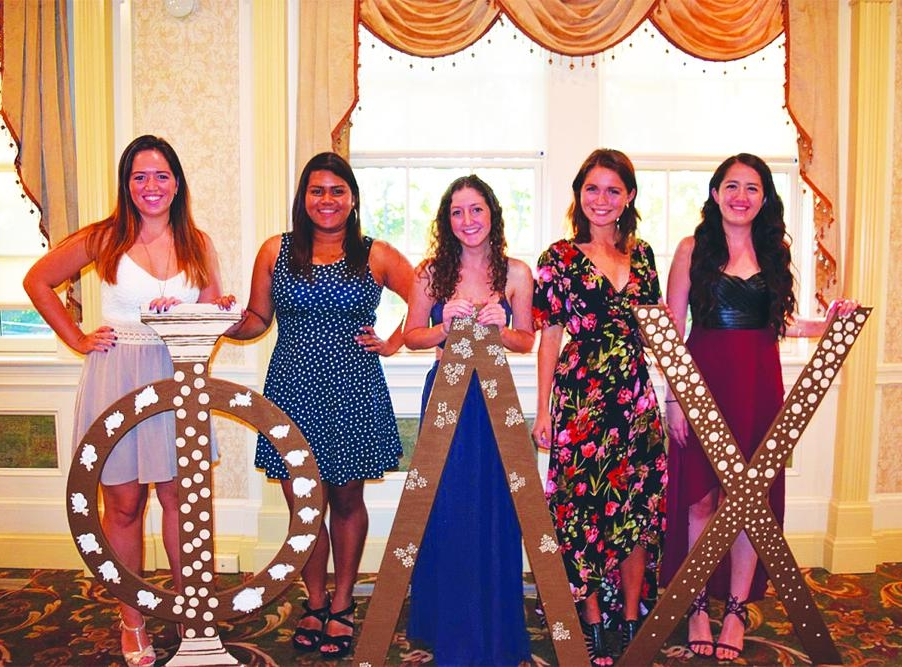 Phi Lambda Chi sisters pose for a quick group shot at their fall 2017 formal event.