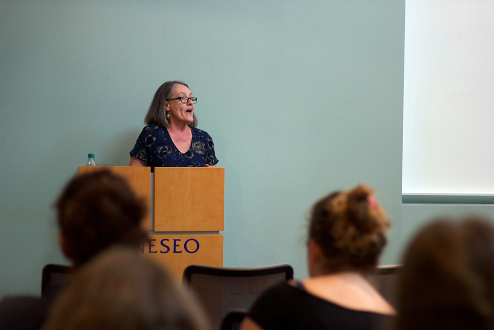 """Professor of English & comparative literature Maria Lima speaking during her lecture, """"Reclaiming the Human: From the Bildungsroman to Neo-Slave Narratives"""" on Monday Sept. 25. The lecture covered the development of the bildungsroman genre. (Hannah McSorley/Staff Photographer"""