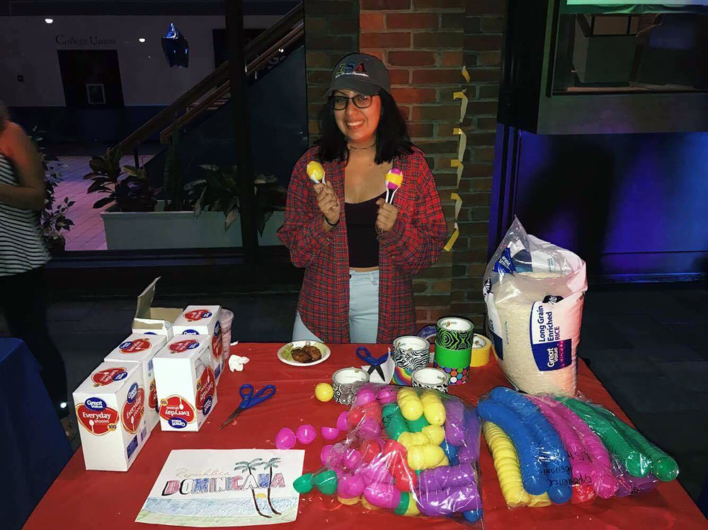 "Latino Student Association president senior Michelle Soria standing at a craft table during the ""Experience Hispanic Heritage Month"" celebration. Besides crafts, the event offered games and traditional food. (Courtesy of Jennifer Barahona)"