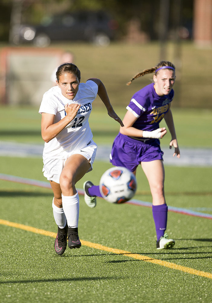 Freshman forward Julia Ophals races to the ball against an Alfred University defender. The Knights earned a 3-0 victory against Alfred on Tuesday Oct. 3, and look to continue this victory streak during their upcoming game against SUNY Brockport on Saturday Oct. 7. (Annalee Bainnson/Photo Editor)