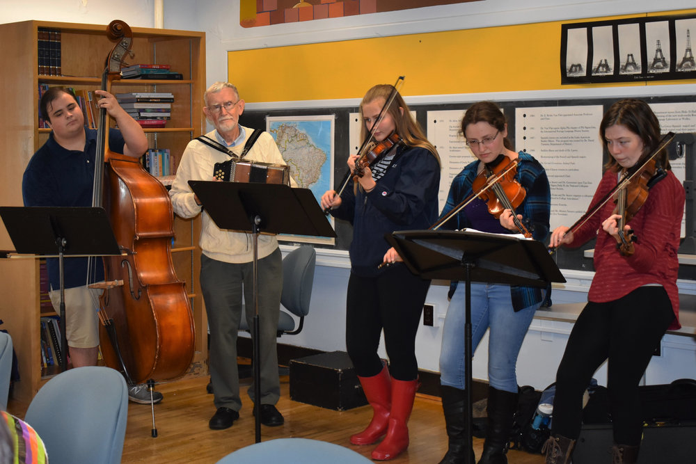 Professor of music James Kimball leading and playing with the Geneseo String Band during German Club's Oktoberfest celebration. The musicians led sing-a-longs of traditional German songs while attendees ate.  (izzy graziano/knights' life editor)