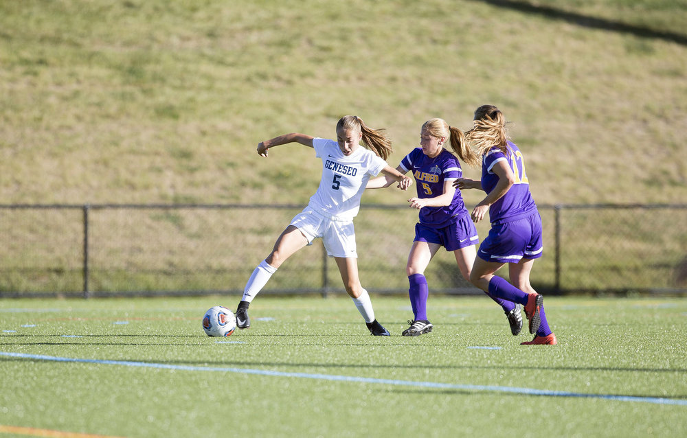 Freshman forward Ellie Gregory hustles to get the ball past Alfred University's defense on Tuesday Oct. 3 in a 3-0 victory. Despite their winning streak, the team fell 1-0 to SUNY Oswego on Saturday Oct. 14, marking their first loss of the best season that the Knights have had in years.