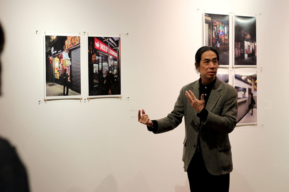 "Chee Wang Ng (pictured left), a Chinese immigrant from Malaysia, featured his works in the Bertha V.B. Lederer Gallery on Oct. 25. His exhibit was called ""Beyond a Bowl of Rice"" and it explored Chinese culture. Ng caught the attention of the attendees with his distinctive views on Chinese traditions and ways of life. (Ellayna Fredericks/Assoc. Photo Editor)"
