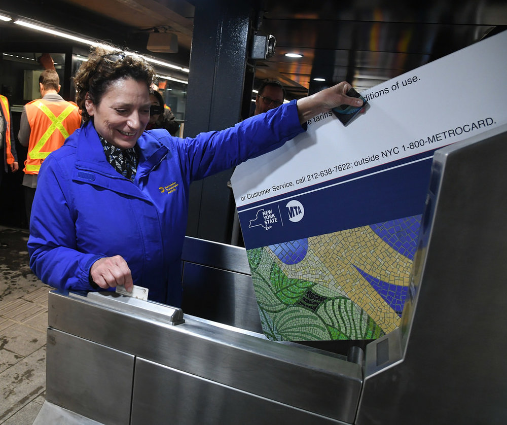 MTA Managing Director Veronique Hakim (pictured above) reopens a subway line in Brooklyn on Sept. 8. The MTA aims to create a better experience for subway and bus riders in New York City by modernizing the card and turnstiles to scan phones and cards. (Mark Hermann/Creative Commons)