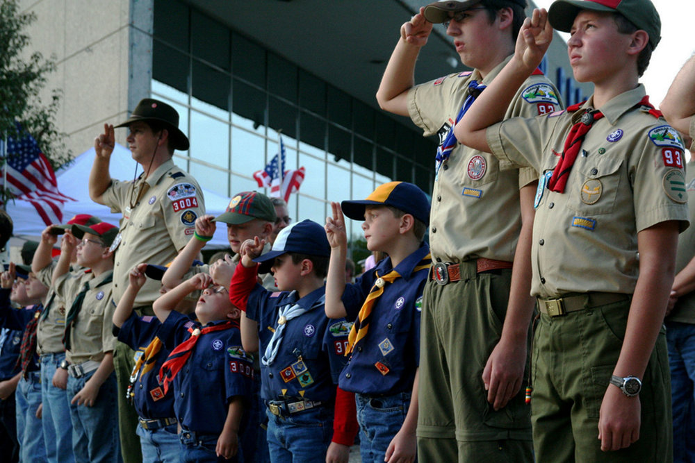 Boy Scouts salute the flag on Sept. 11, 2008 at the Gerald R. Ford Museum (pictured above.) The decision to encourage girls to join the previously male-only group signifies a progressive change. (Steven Depolo/Creative Commons)