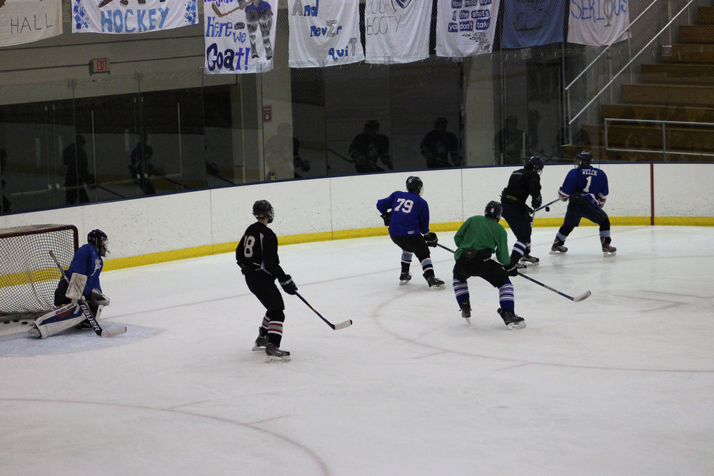 The Geneseo men's club hockey team, the Geneseqs, holds late night practices in the Ira S. Wilson Ice Arena twice a week in preparation for their league games. Despite not having a coach, the men have started their promising 2017 season with a 7-2 victory over Mercyhurst College on Oct. 20. The team effort displayed by the Geneseqs is what makes the organization unique. (Ellayna Fredericks/Assoc. Photo Editor)