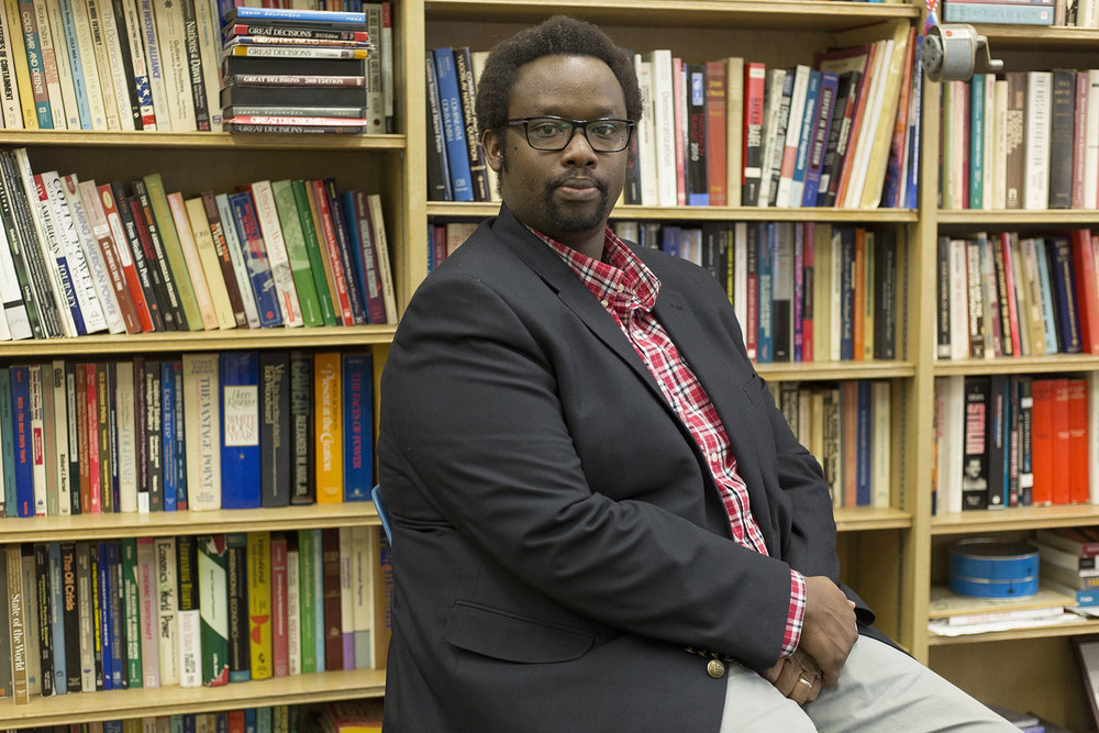 Visiting assistant professor of political science Reverien Mfizi immigrated from Rwanda to Pittsburgh, Pa. in 2000. While in Rwanda, Mfizi survived a civil war that culminated in holocaust. (Annalee Bainnson/Photo Editor)