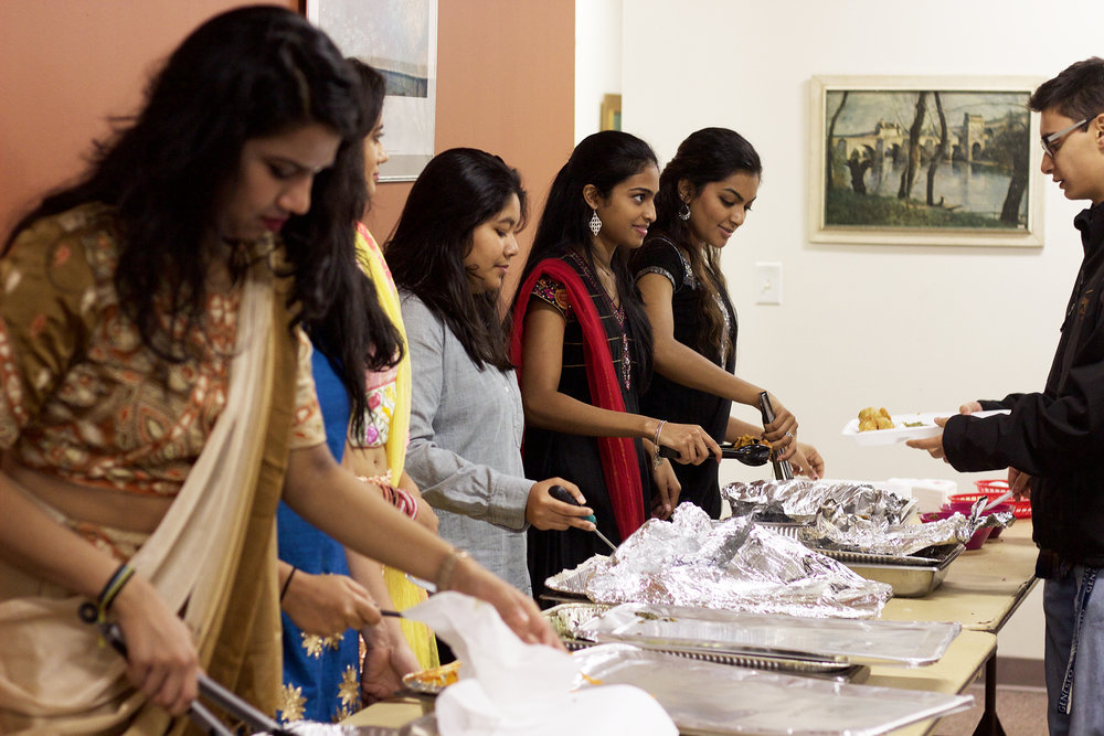 Shakti members (pictured above) serving Indian food catered by Raj Mahal Indian restaurant at Garba Night on Saturday Nov. 4. The event also featured tutorials of traditional dancing styles led by Shakti members. (Elizabeth Jacobs/Staff Photographer)