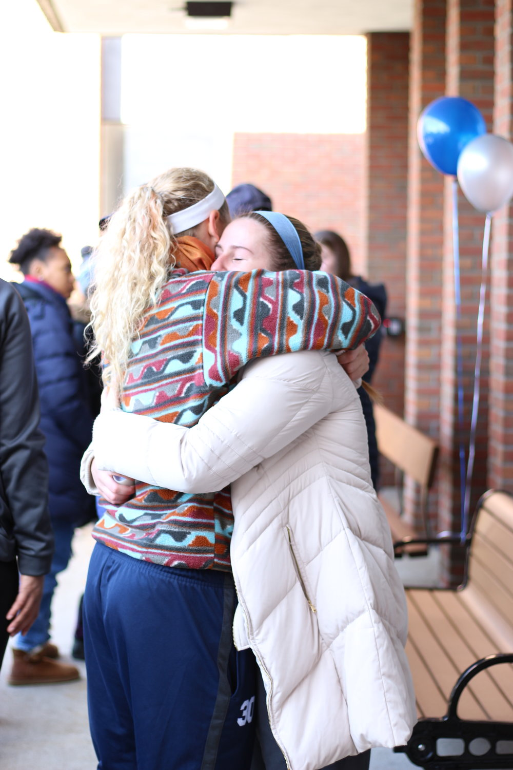 Friends, teammates and family of Savannah Williams gathered in front of Onondaga Hall on Saturday Nov. 11 to pay their respects and see the bench inscribed with her name (pictured top). Savannah Williams passed away after the fall of 2016, as she was travelling home for winter break. (Ellayna Fredericks/assoc. photo editor)