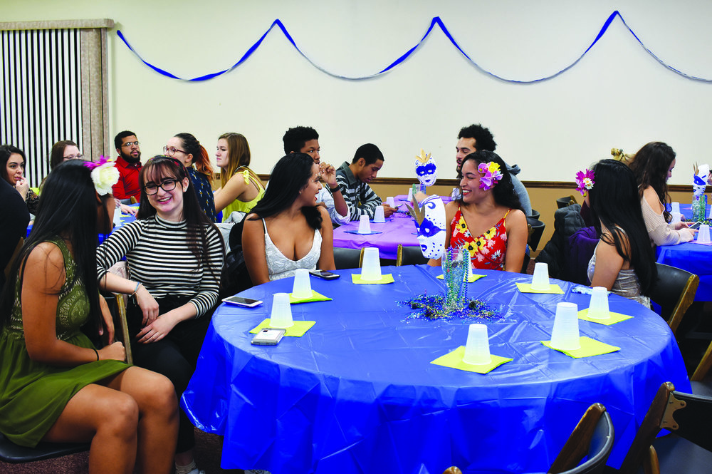 "Latino Student Association members (pictured above) enjoying ""La Mezcla: Carnaval"" on Saturday Nov. 11. The event featured both traditional food, catered by D'Mangu Restaurant, and entertainment. (Izzy Graziano/knights' life editor)"