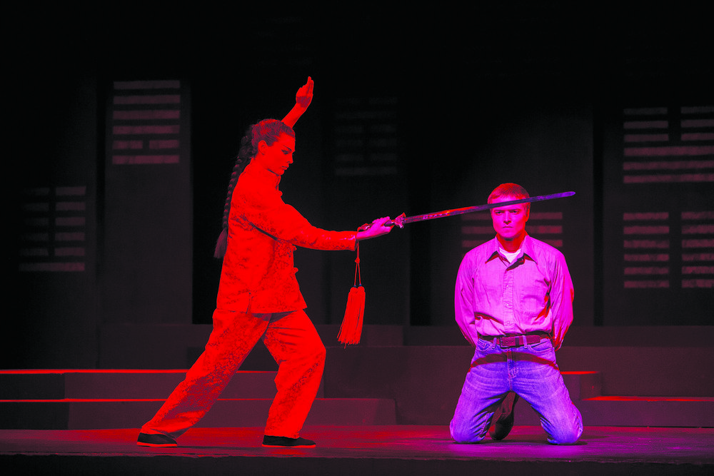 "The Geneseo Department of of Theater and Dance presented ""Carry the Tiger to the Mountain"" on Nov. 8 to Sunday Nov. 12 in the Alice Austin Theatre. The play follows the real stories of Chinese immigrants and the alienation they face as Chinese Americans. Pictured above on the left is Michelle Cooman '17--who played Fa Mulan--and childhood special education major senior Jack Swanger, who played Donald Evans. (Courtesy of Ben Gajewski)"