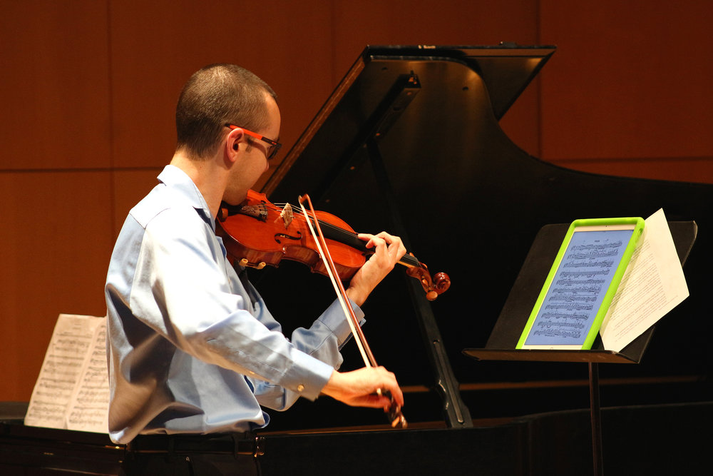 Visiting assistant professor of violin Andrew Bergevin (pictured above) held a faculty recital on Saturday Nov. 11 in Doty Recital Hall alongside renowned pianist Elena Nezhdanova and cellist Roman Placzek. The three musicians played many pieces that ellicted images of Soviet Russian lifestyle, such as dull labor and factory work. (Ellayna Fredericks/Assoc. Photo Editor)
