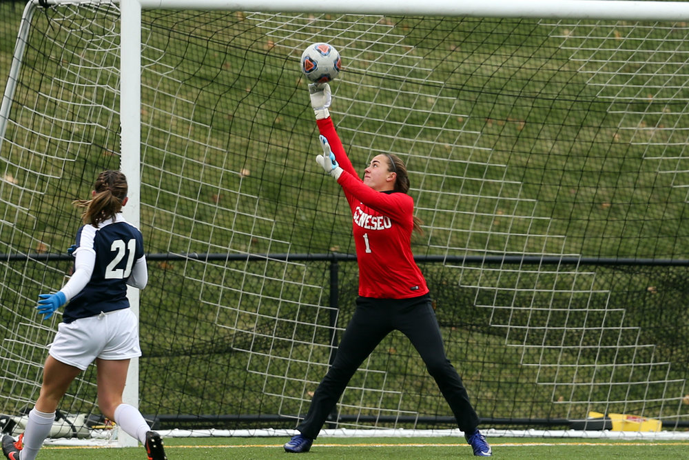 unior goalkeeper Emily Janiszewski blocks a shot during the Knights' game against Misericordia University on Sunday Nov. 12. The women will travel to Massachusetts to compete against John Hopkins University in the third round of the NCAA Tournament on Saturday Nov. 18. (courtesy of Ben Gajewski)