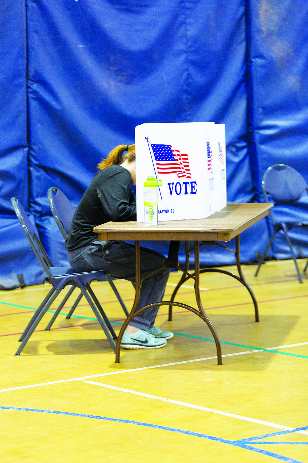 A student (pictured above) votes at Kuhl Gymnasium on-campus on Nov. 7. It is imperative that more individuals become educated on local politics and become more involved in electing officials in their own towns and districts. (Annalee Bainnson/ Photo Editor)