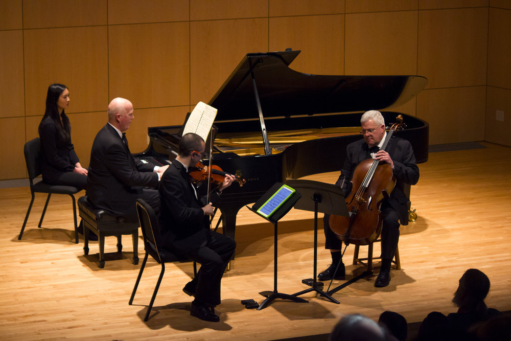The Geneseo Piano Trio performed on Sunday Dec. 3 in Doty Recital Hall in a emotive concert. The trio, pictured above, consisted of assistant professor of violin Andrew Bergevin on the violin, lecturer of music James Kirkwood on the cello and professor of music Jonathan Gonder on the piano. (Catherine White/Arts & Entertainment Editor