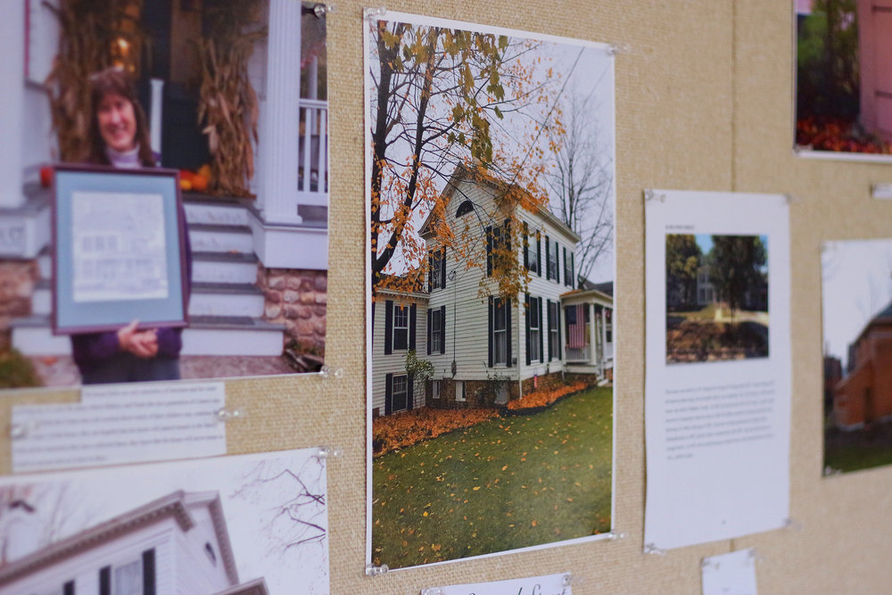 "Students in the museum studies minor displayed an exhibit in the Brodie Bridge Gallery on Nov. 29 entitled ""Five Geneseo Houses: Living History in an American Landscape."" The feature explored the history behind five houses in Geneseo as the students were able to interview the residents, and research more on the homes themselves. (Ellayna Fredericks/Assoc. Photo Editor)"