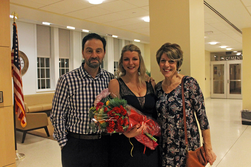 The Floriano family (pictured above) has distinguished themselves as integral members of the Geneseo music department. Vocal performance major junior Maria Floriano (pictured center) recently performed a solo recital, while parents Joan (pictured right) and Gerard (pictured left) hold faculty positions. (Sophie Yeomans/Asst. Copy Editor)