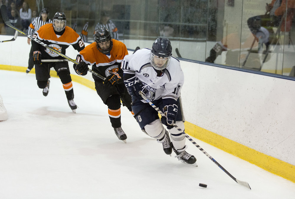 Sophomore forward Conlan Keenan makes a break away against the Buffalo State Bengals on Nov. 3. The Ice Knights did not achieve the results that they anticipated, as they added both a tie and a loss to their near perfect record. (Annalee Bainnson/Photo Editor)