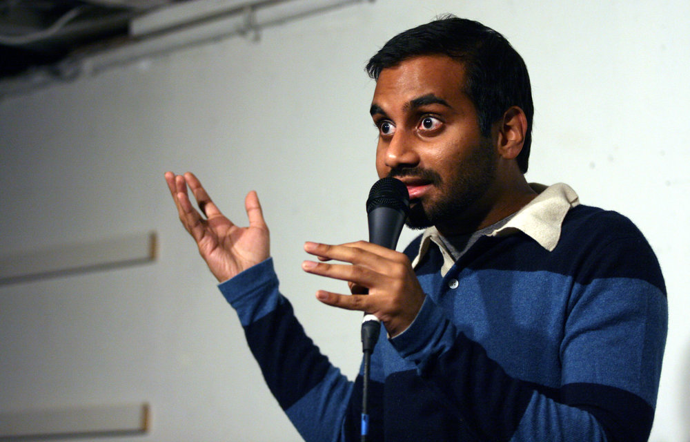 "Aziz Ansari, 2018 Golden Globe Winner and comedian, performing in 2011. Ansari is a known advocate for women's rights. Consent issues brought to the press by a former partner have sparked debate among the ""#Time'sUp"" movement. (Tyler Ross/creative commons)"