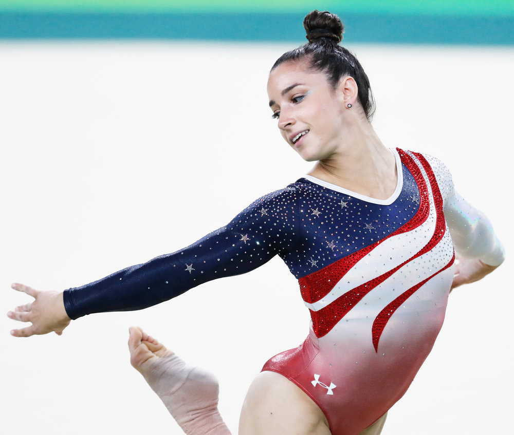 Ali Raisman competes in the Rio 2016 Olympic Games in Brazil (pictured above). Raisman was one of the individuals assaulted by Nassar and while she immediately did not want to testify, she eventually came forward and spoke at the trial due to the comforting nature set by Judge Rosemarie Aquilina. (Courtesy of Creative Commons)