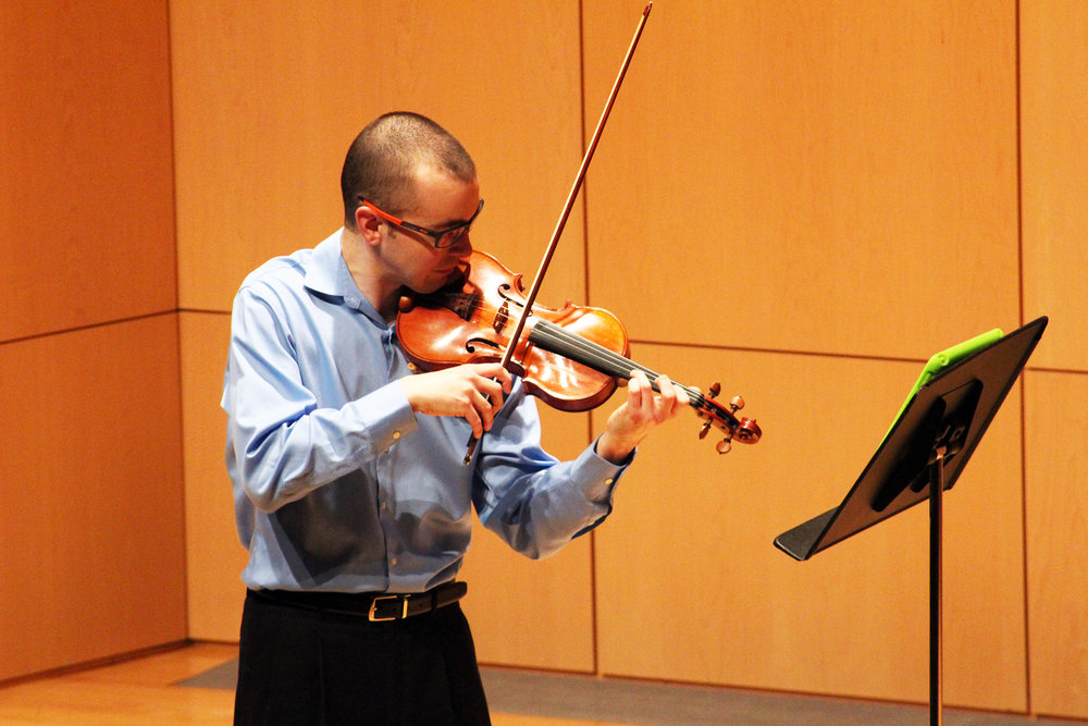 Pictured above is visiting assistant professor of violin Andrew Bergevin performing in his faculty recital on Saturday Jan. 27 in the Doty Recital Hall. Bergevin played one solo piece, a violin duet with violinist Timna Mayer and a piano and violin collaboration with adjunct professor of music Jeong-Eun Lee. (Catherine White/ Arts & Entertainment Editor)