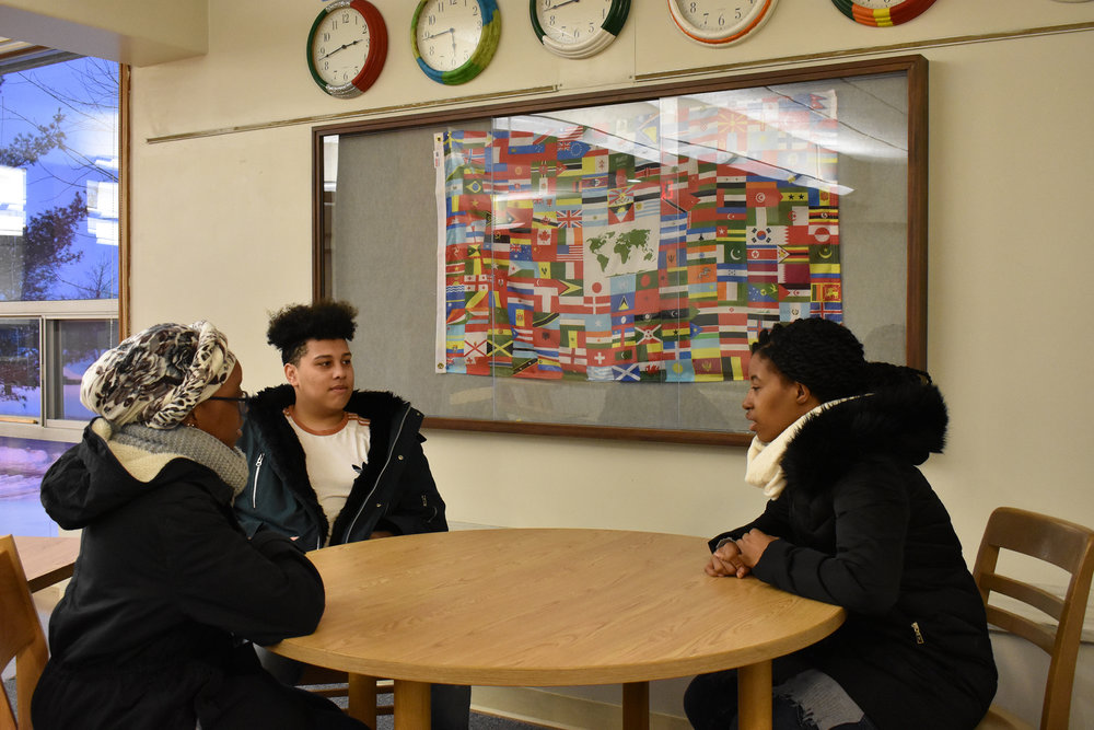 International relations major junior Shekiqua Reid (pictured right),  communication major junior Luc Turnier (pictured center) and psychology major sophomore Oumou Wague (pictured left) sit in the common room of Wyoming Hall.  Wyoming Hall is home to the Global House Living-Learning  Community and in the fall 2018 it will house a new LLC focused on food culture. (Izzy Graziano/Knights'  Life Editor )