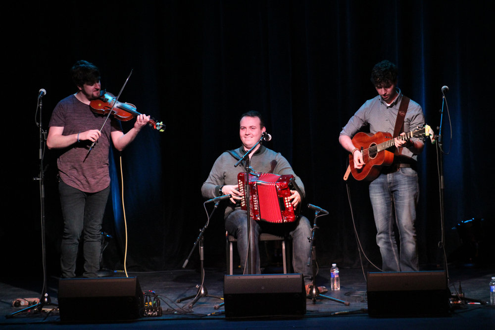 Socks in the Frying Pan, a Celtic band native to Ennis County Clare, Ireland, performed for Limelight and Accent's first show of the semester on Saturday Feb. 3 in the Wadsworth Auditorium. Pictured above are the three artists from left to right: Fiachra Hayes on the fiddle, Shane Hayes on the accordion and Aodán Coyne on the acoustic guitar. The band interacted with an engaged audience, while sharing upbeat Irish tunes. (Catherine White/Arts & Entertainment Editor)