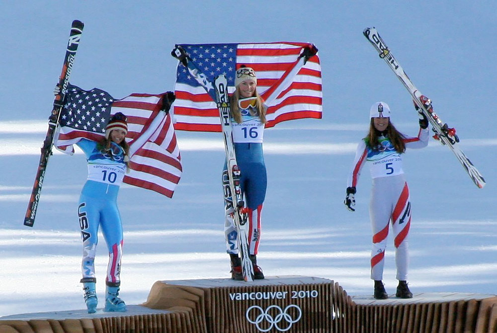 Julia Mancuso (pictured left) and Lindsey Vonn (pictured right) receive their medals for the Women's Downhill Skiing at the 2010 Winter Olympics. Female Olympic athletes are frequently subject to worse treatment than their male counterparts. This is unacceptable and moving forward it is necessary to hold all athletes to the same standards, regardless of gender. (Courtesy of Creative Commons)