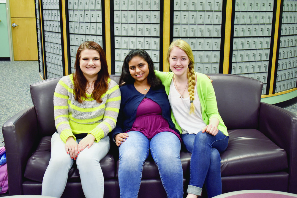Voices Uncovered is a new organization founded by English major sophomore Sandy Brahaspat (pictured middle). The club is based off of The ToKnight Show, a comedy troupe founded by history major senior Jenna Lawson (pictured left), and allows students to present their opinions on injustices minority groups face in an inventive way. The club's official blog photographer sophomore Whitley Brincka is pictured right. (Izzy Graziano/Knights' Life Editor)