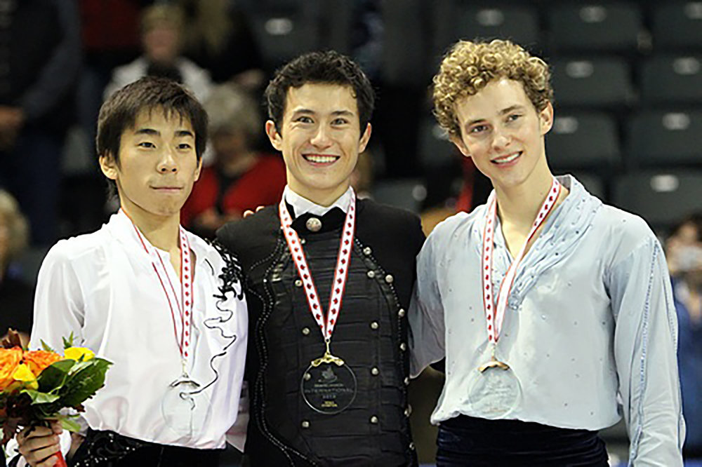 Nobunari Oda (pictured left), Patrick Chan ( pictured center) and Adam Rippon (pictured right) at the 2010 Skate Canada International. Rippon has been a continual role model for the LGBTQ+ community in athletics. Since Rippon has paved the way, an increasingly accepting sentiment has been demonstrated during the 2018 Winter Olympics. (David Carmichael/creative commons)