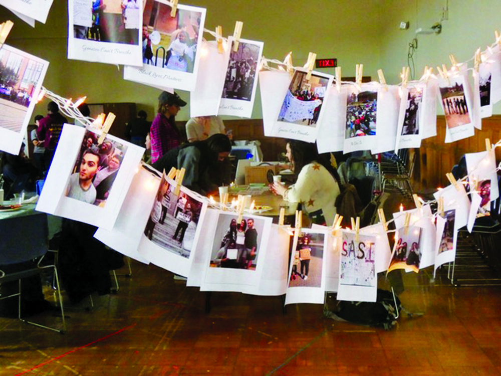 Students Against Social Injustice held their annual Express Yaself event on Sunday Feb. 25 in Sturges Auditorium. The event featured booths from different Geneseo activist groups and students who expressed current social problems through art forms like poetry. Pictured  above is a photo display of different organizations' events and protests. (Sophie Yeomans/Asst. Copy Editor)
