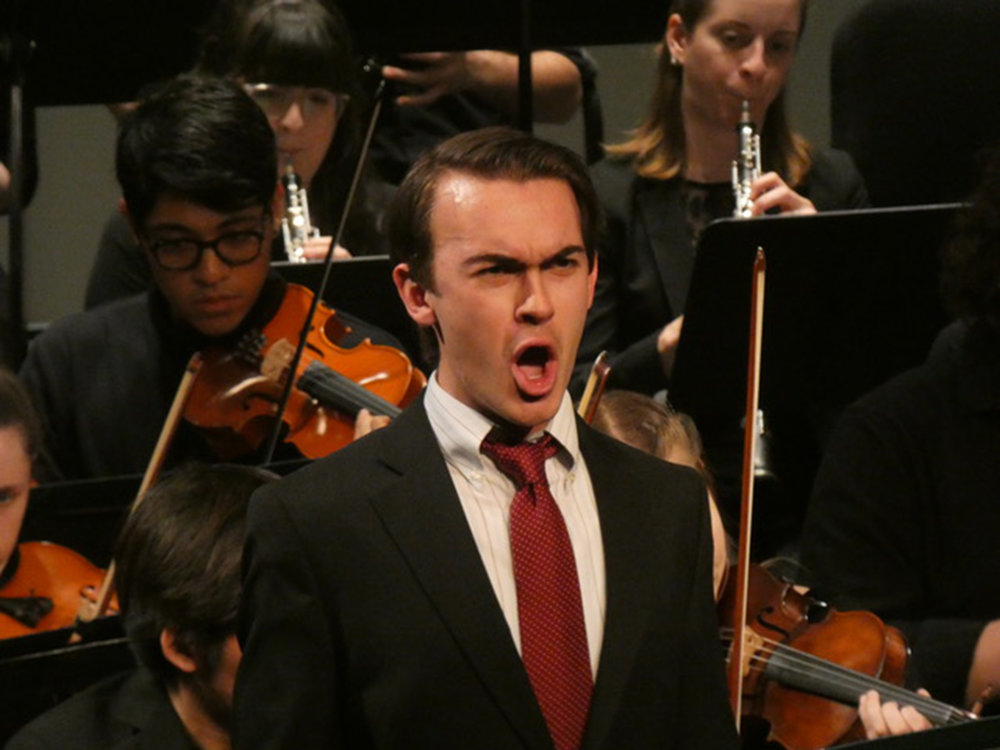 "Baritone senior Noah Chichester (pictured above) sang Mozart's aria ""Non piu andrai"" with the Geneseo Symphony Orchestra in their concert ""Mother Tongue"" on Sunday Feb. 25 in the Wadsworth Auditorium. The performance featured Chichester and trumpeter sophomore Samuel Dole. (Sophie Yeomans/Asst. Copy Editor)"