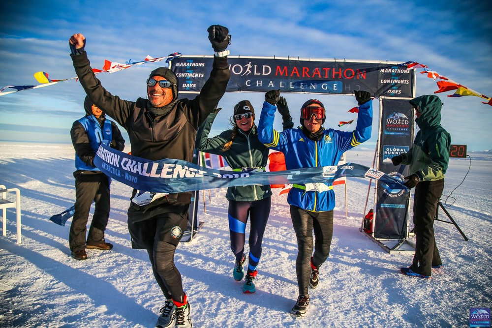 Geneseo alumna Cara Nelson '09 running the first marathon as part of her seven marathon race in Antarctica (pictured center). Nelson encourages Geneseo students to pursue their dreams, no matter how large they seem. (Courtesy of Cara Nelson)
