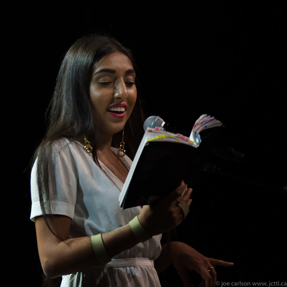 Rupi Kaur (pictured above) reads from one of her best-selling books, the voice of her generation, in Vancouver in 2017. Kaur is an inspiration for all individuals in the publishing industry, especially minorities, as she continues to overcome prejudice and criticism regarding her poetry. (Joe Carlson/ Creative Commons)