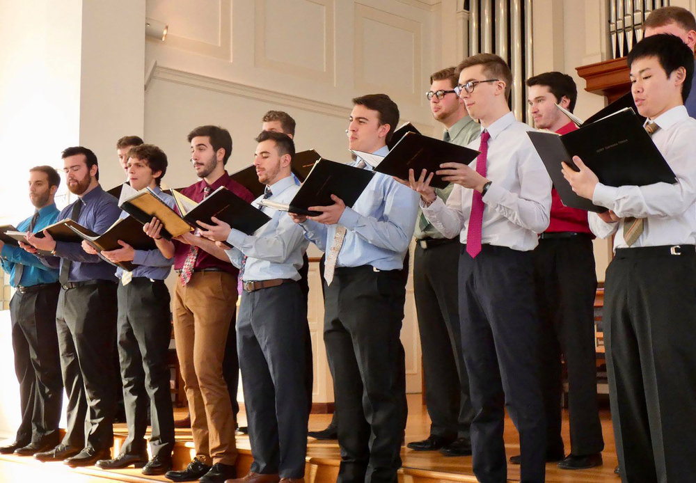 """The Geneseo Men's Choir (pictured above) performed alongside the Spectrum Singers and the Geneseo Chamber Singers on March 4 in the Central Presbyterian Church. Some of the pieces sung by the groups included """"Wade in the Watah"""" by Ysaye Barnwell and """"The Water is Wide,"""" a piece arranged by history and adolescent education double major senior Noah Chichester. (Sophie Yeomans/Asst. Copy Editor)"""