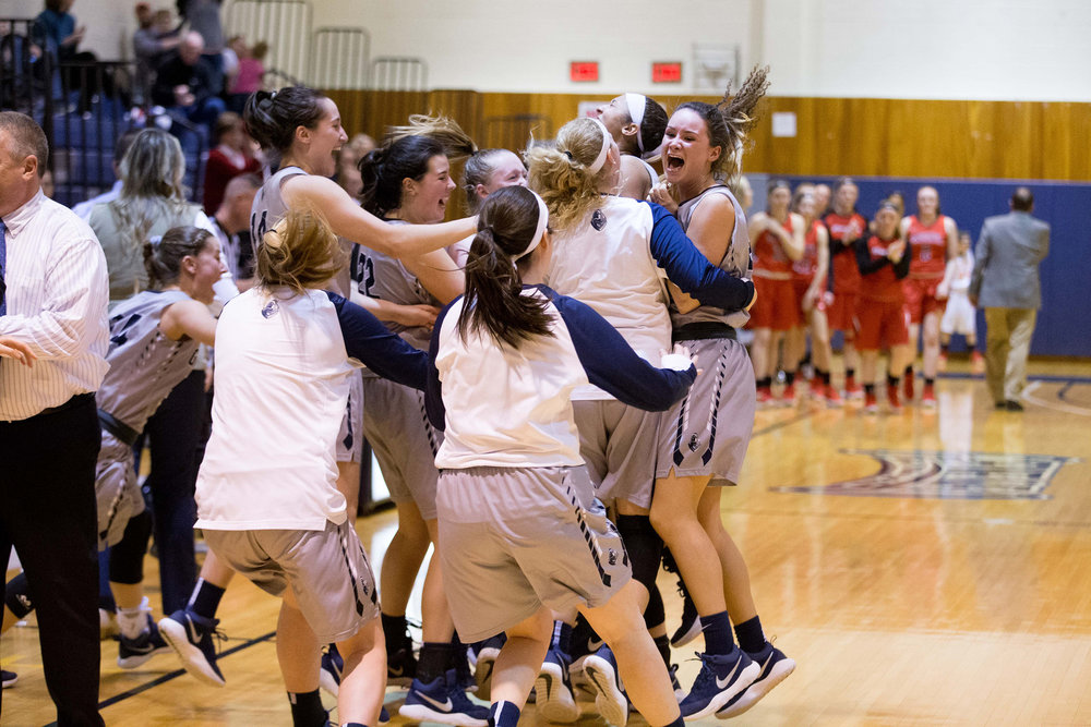 The women celebrate their victory over SUNY Oneonta in the SUNYAC Championship on Feb. 24. Although the Knights had a nearly perfect season, they were unable to hold their own against Ithaca College during the NCAA Tournament, causing their 2017-18 season to come to an end. (Keith Walters/director of multimedia)
