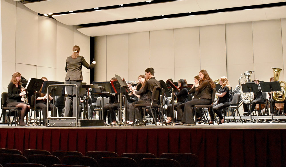 The Geneseo Wind Ensemble (pictured above) performed on Friday March 23 in the Wadsworth Auditorium. Under Coordinator of Instrumental Activities Leah McGray, who conducted the concert, the ensemble played songs strictly by composers from New York State, excluding Libby Larsen. (Izzy graziano/Knights' Life Editor)