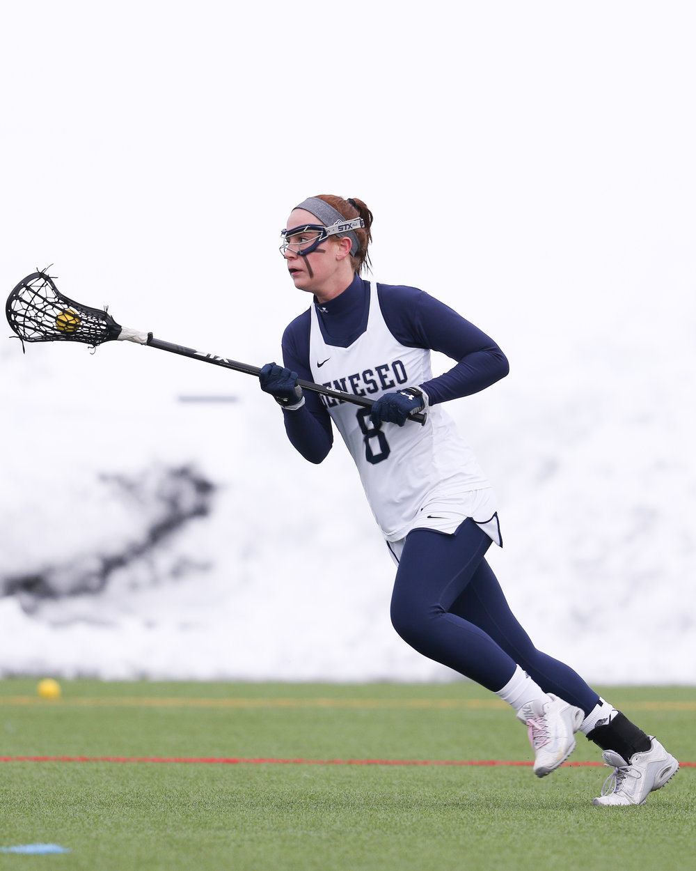 Senior midfielder Erin Cregan (pictured above) runs up the field in search of the net during a game against the University of Rochester on March 8. The women have a seven game win streak that they hope to continue as they face SUNY Oneonta on Saturday March 31. ()