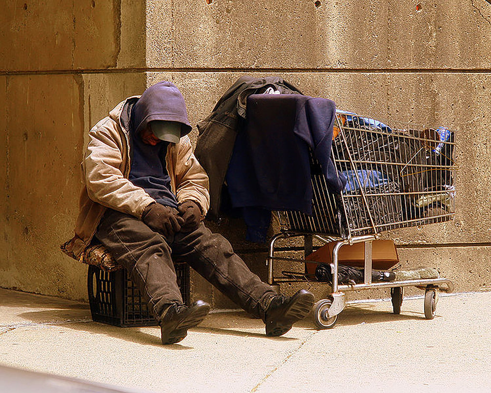 A homeless man (pictured above) in Boston. It seems that society has become accustomed to seeing homeless individuals on the streets in urban areas, causing a lack of empathy for them. This is unacceptable and increased awareness and advocacy for homelessness is necessary to help these individuals. (Matthew Woitunski/creative commons)