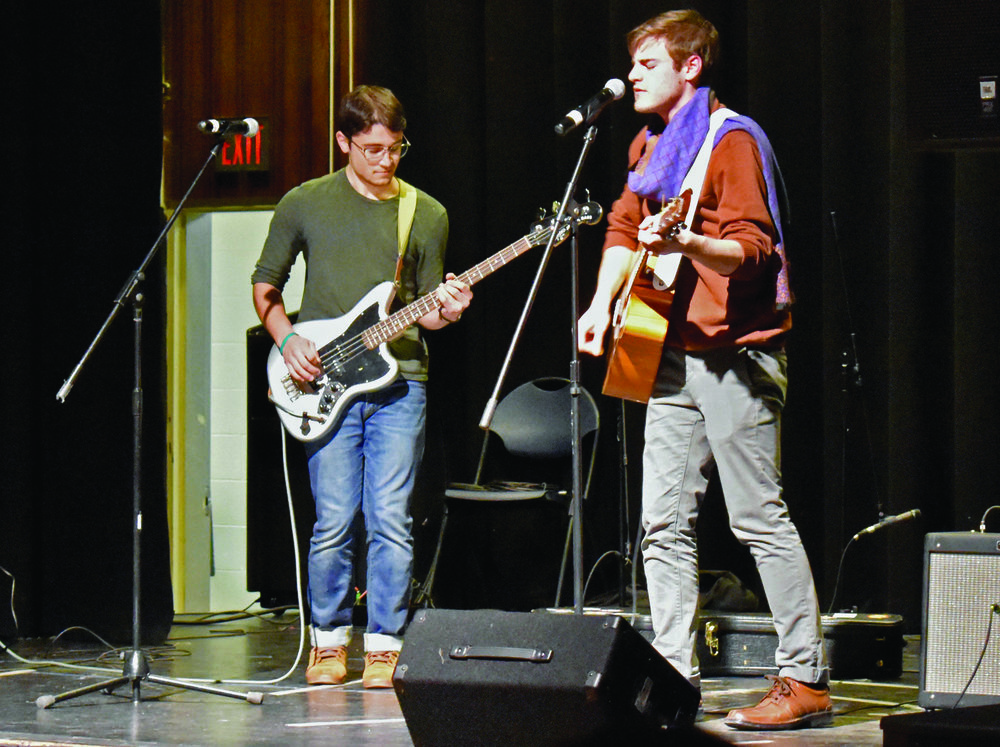 "Pictured above from left to right is geography major senior Peter Scilla and geography major senior Anthony ""AJ"" Giaccio who are part of the band Prunee. Prunee was one of the seven bands that performed at Geneseo Campus Activites Board's Battle of the Bands on Thursday April 12 in the MacVittie College Union ballroom.  (Izzy Graziano/Knights' Life Editor)"