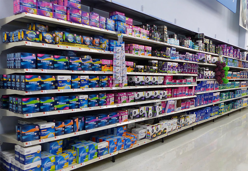Feminine products (pictured above) sold in Walmart in the United States. These products are very expensive and a requirement for women's health and safety. Providing free supplies is essential and will foster greater equality. (Courtesy of Creative Commons)