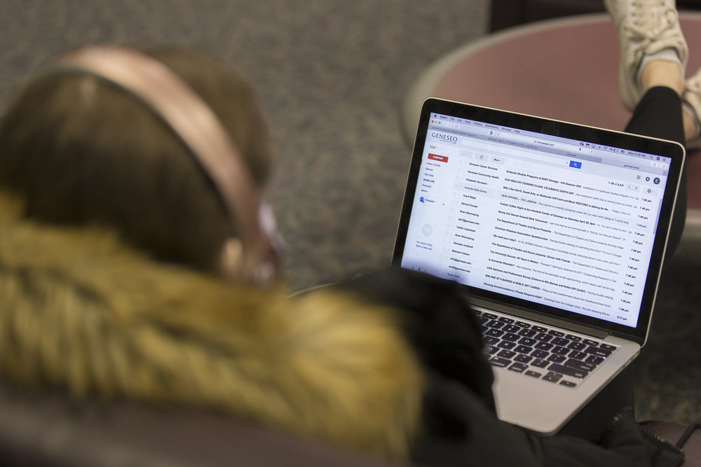 A student uses her laptop to access her Geneseo email account. Security concerns over the college's policy on email privacy came about after two University of Rochester professor's emails were searched by investigators following their claims of sexual misconduct against a fellow colleague (Annalee Bainnson/Photo Editor).