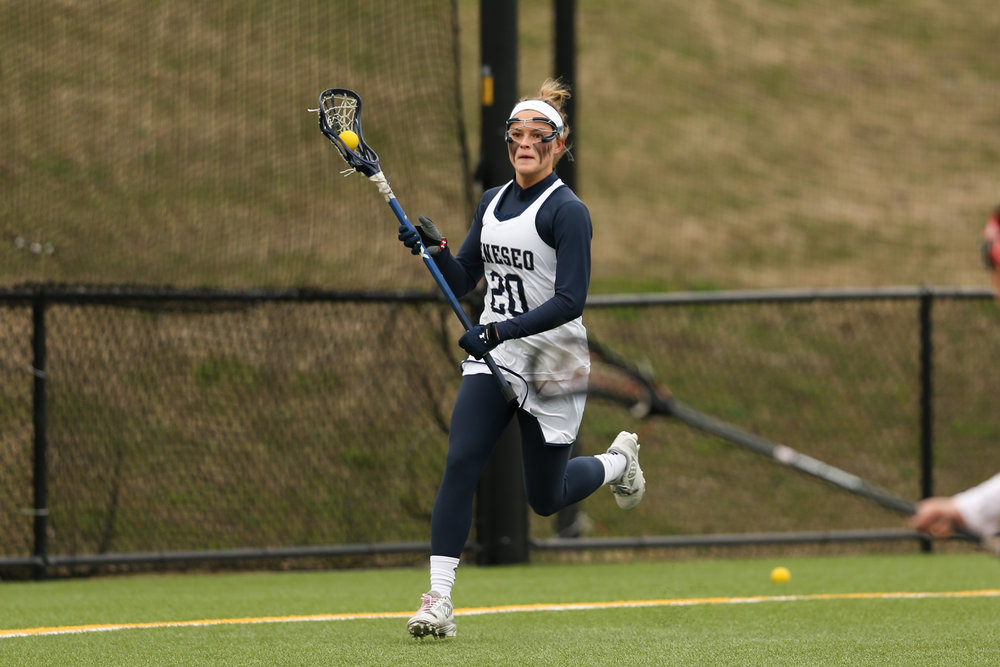 Junior defender Mallory Max heads up the field in search of an open teammate during the game against SUNY Cortland on Saturday April 14. The women experienced the first two losses of the season, and refuse to let it bring down their spirits.  (courtesy of Ben Gajewski)