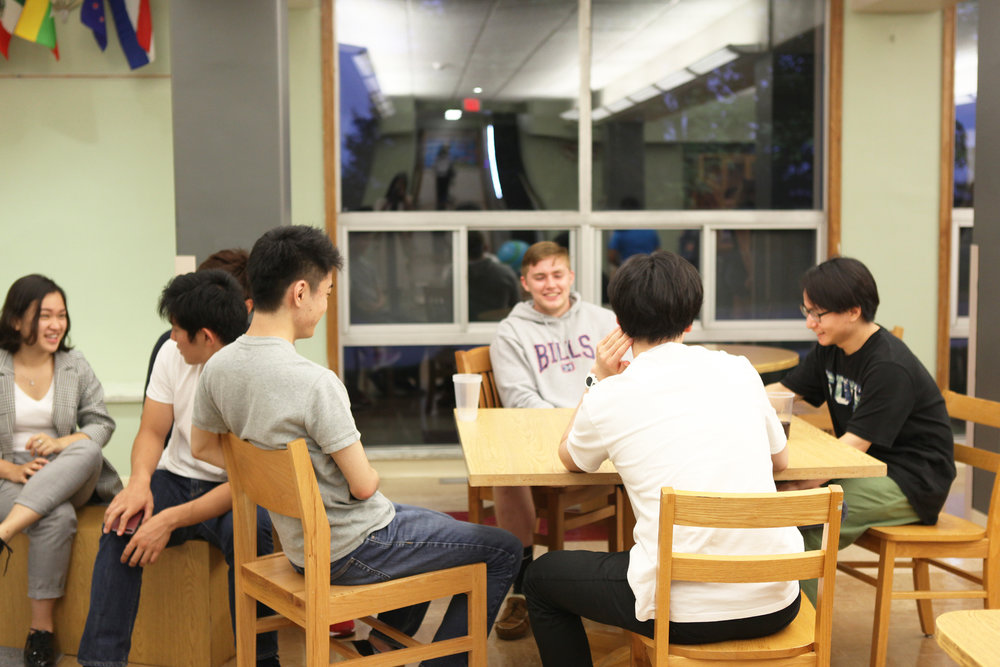 Students socialize at International Game Night in Wyoming Hall (pictured above) on Aug 22. New Resident Assistant contracts include stipulations that suggest a shift in priorities, creating some discontent among RAs (UdeshI Seneviratne/photo editor).