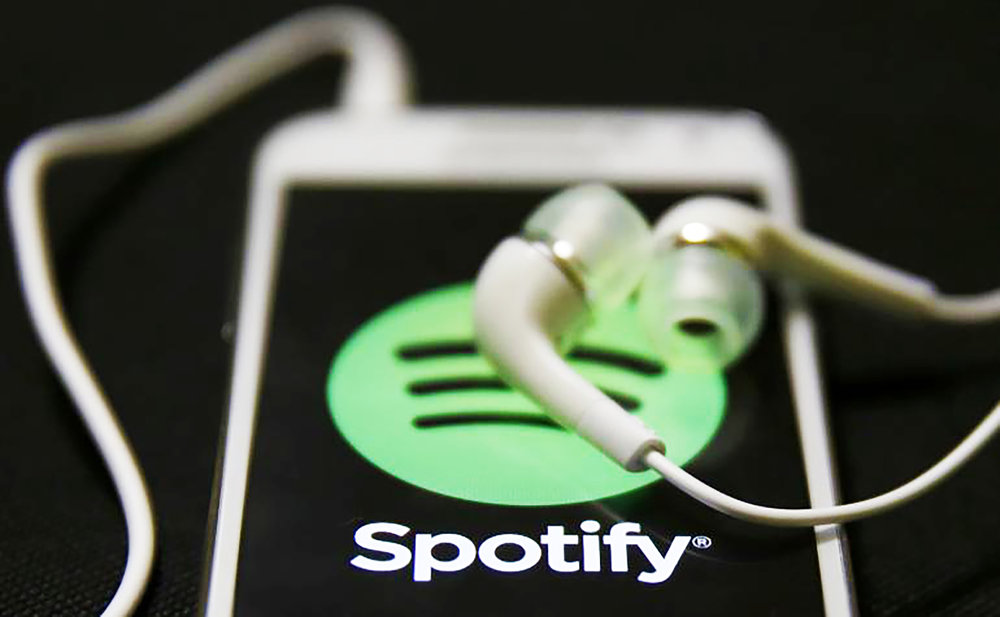 The music-streaming app Spotify is keeping music sales to a minimum, forcing artists to find other revenue opportunities. Musicians have been increased the amount of songs on their albums, sold more tour dates and put out more merchandise to compensate for lack of music sales (courtesy of Creative Commons).