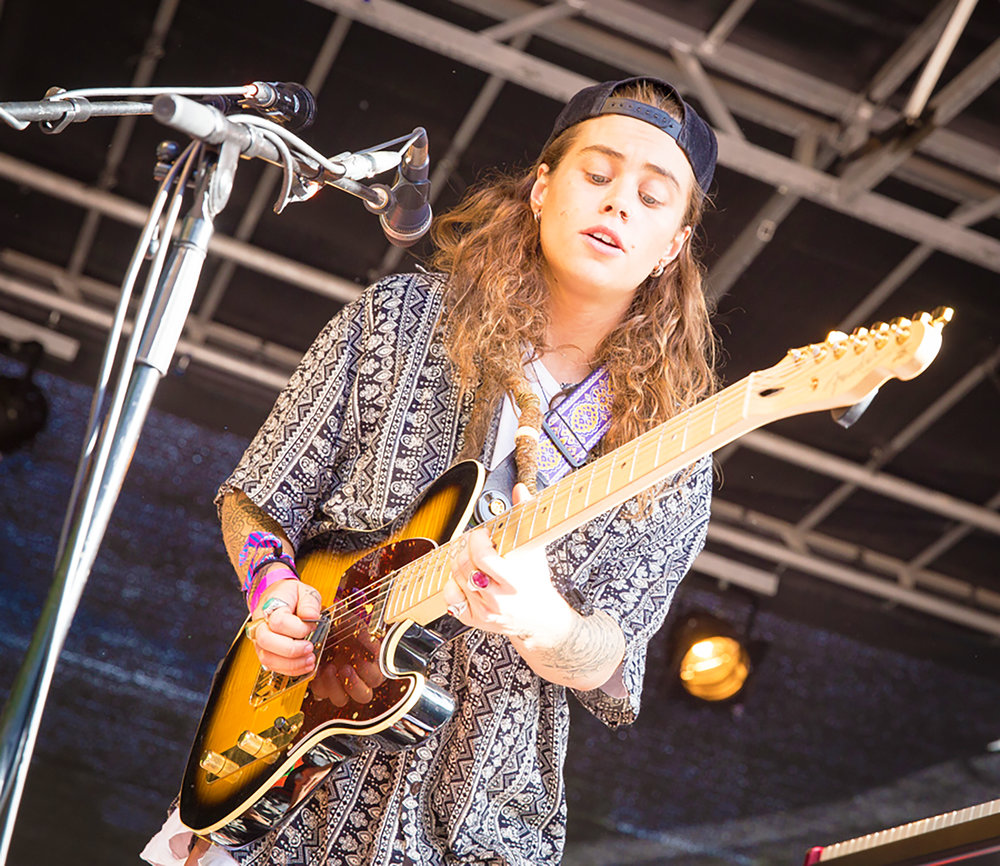 Artist Tash Sultana (pictured above) sings and plays guitar for their performance at Vigeland Park in Oslo, Norway. Sultana expresses the struggle they had with their identity on the new album  Flow State ( courtesy of Creative Commons ) .