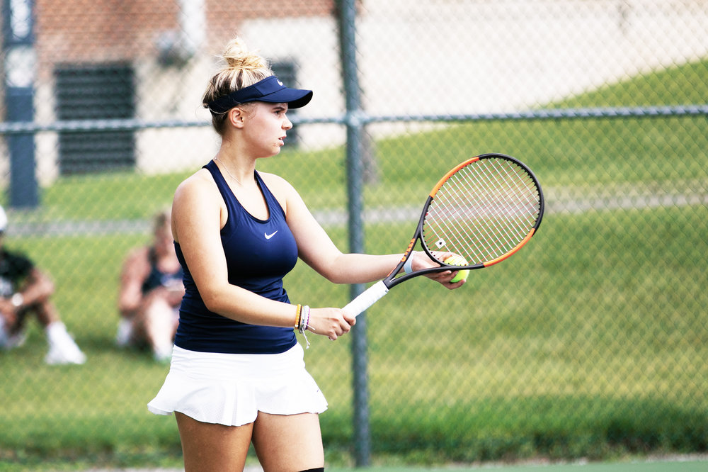 Freshman Olga Shvetsova prepares to serve in the Knights' 7-2 victory over Cortland on Friday, Sept. 14 (pictured above). Shvetsova was able to secure a victory for the team in straight sets at the first singles spot (keith walters/director of multimedia).