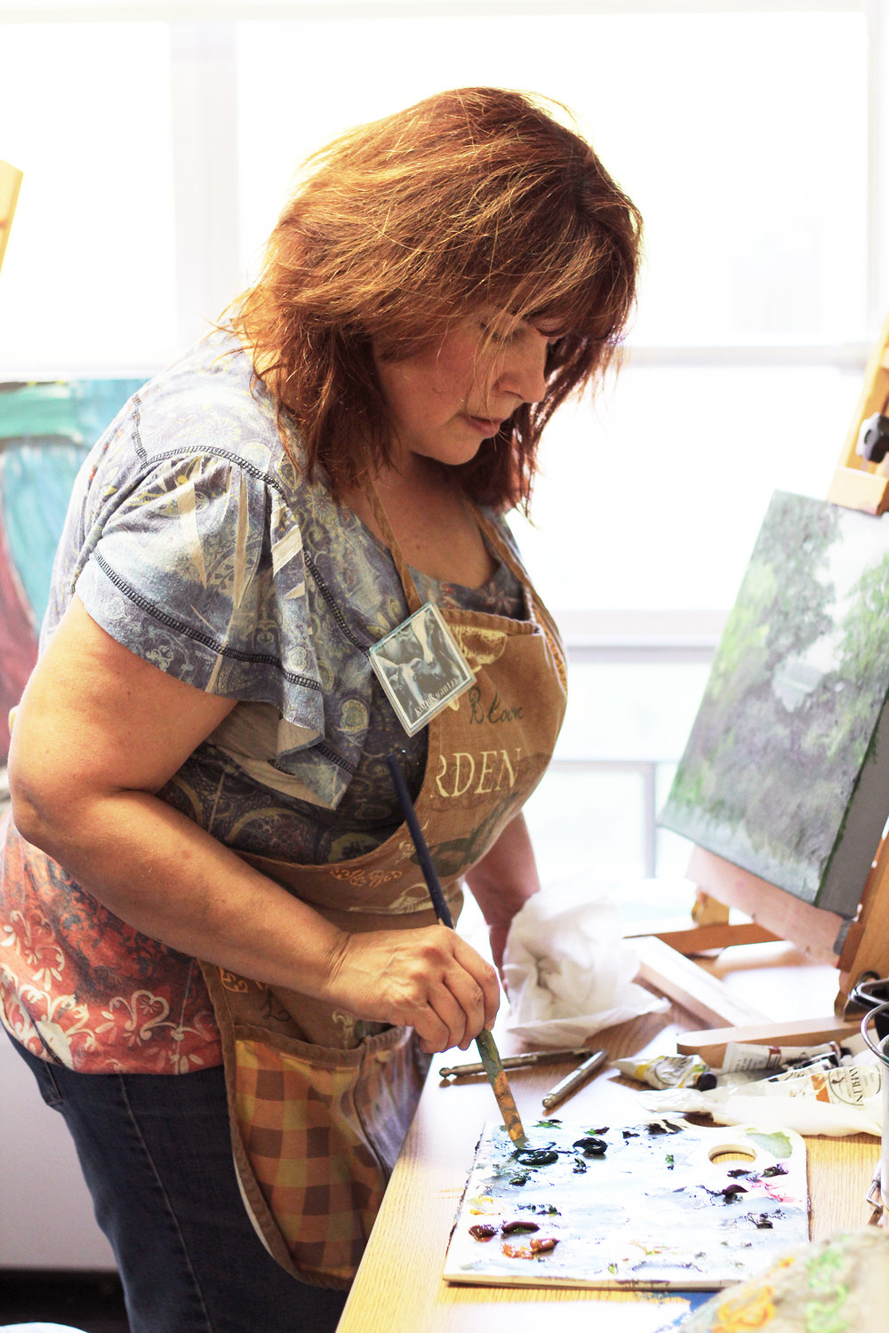 Kim Binaghi Lee has always maintained an admiration for the arts. She has partnered with Nassau Hall to help students with their artwork on Tuesdays from 6 p.m. to 8 p.m. in the Nassau Hall painting studio (Catherine White/editor-in-chief).