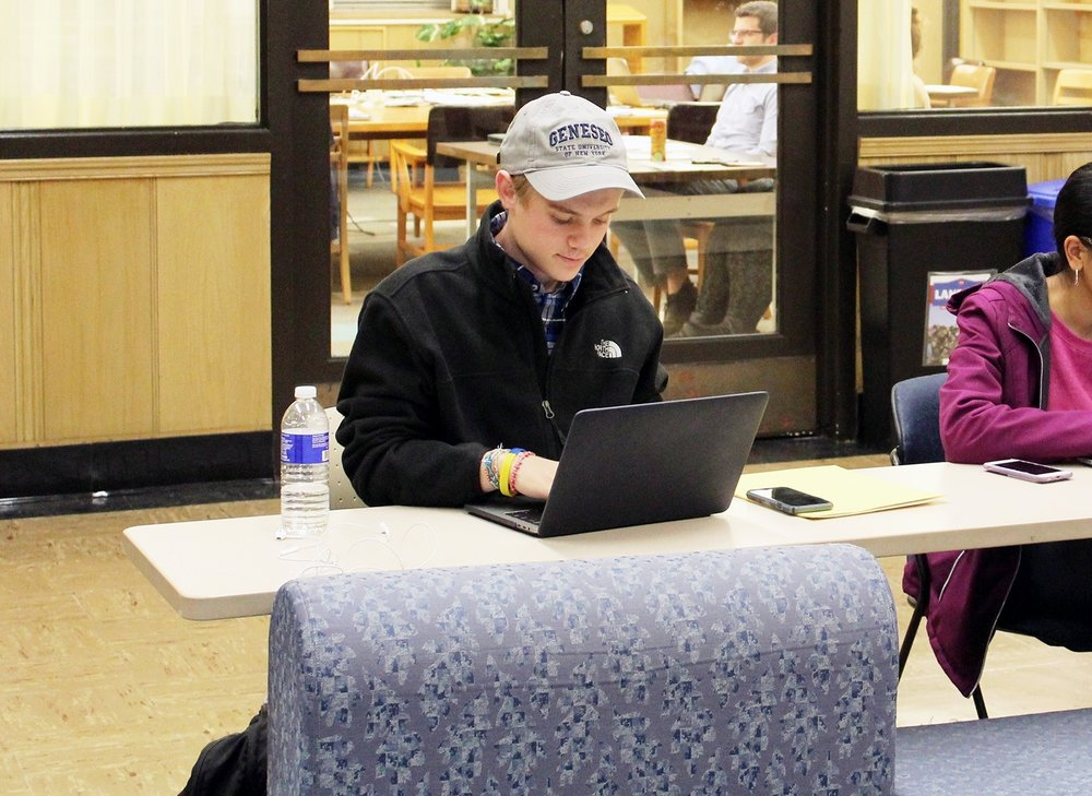 Biology major freshman Jack Donaldson studies in Fraser Hall (pictured above). Fraser Library is one area that the college has considered extending the hours of to create more time for students to work and study. (Malachy Dempsey/Managing Editor)