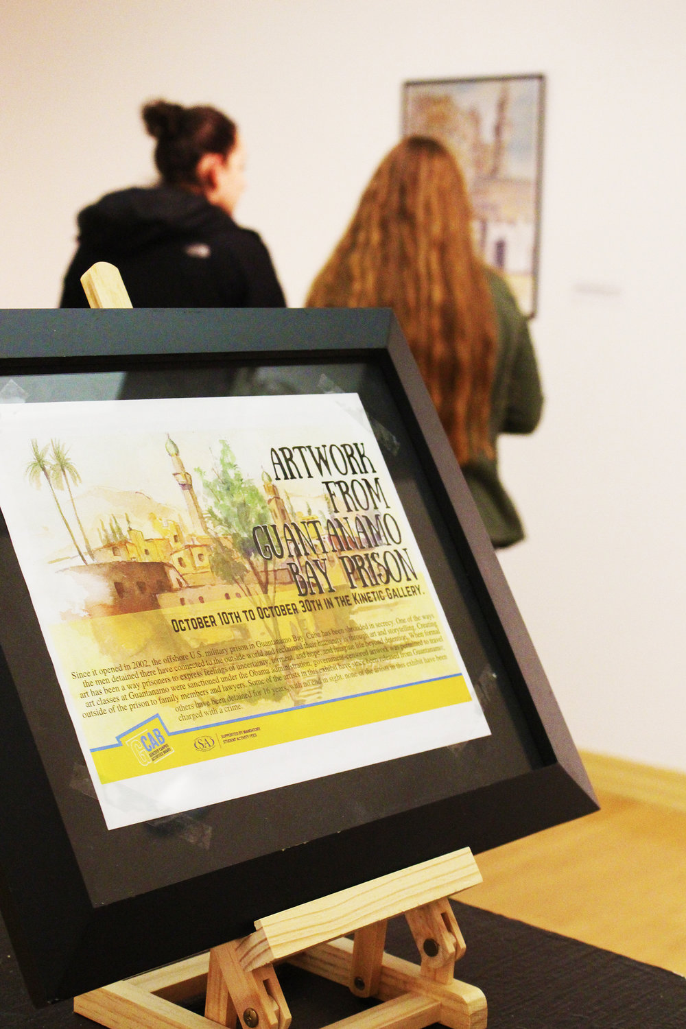 "The Kinetic Gallery exhibit ""Artwork from Guantanamo Bay Prison"" opened on Oct. 10. It displays works by several Guantanamo Bay detention camp prisoners who are not charged with crimes but remain in the prison. (Michaela VanWormer/Staff photographer)"